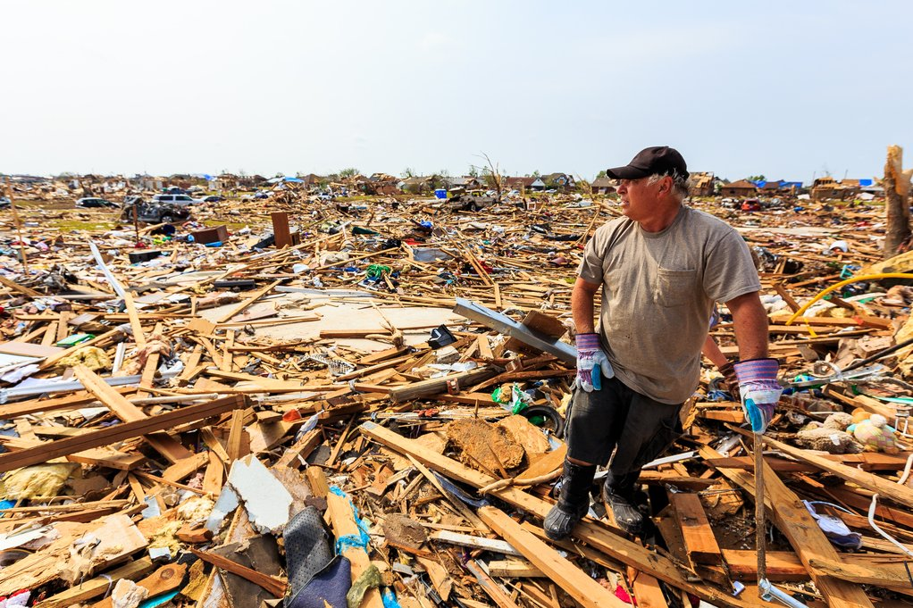 Homeowner looks at the Remain of His Neighborhood